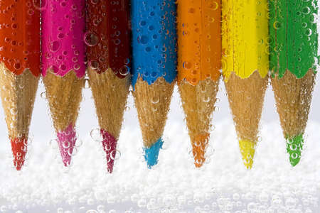 backgraound: colorful pencils on white background with water bubbles Stock Photo