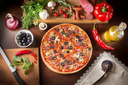 caper: Pizza with ham, pepper and olives. Pepperoni pizza with kalamata olives. Supreme Pizza and olive oil.