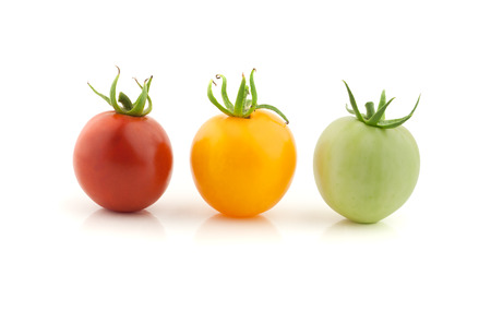 next stage: mature stages, three tomato red, green, yellow on white