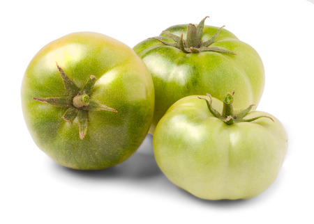 jhy: Green tomatoes on white background Stock Photo
