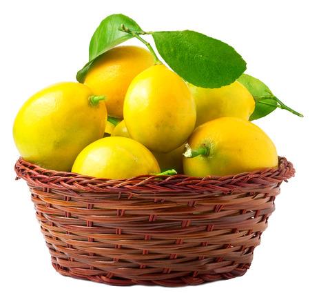 lemon: Lemons in basket isolated on white.
