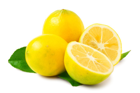 two and a half: Two Lemons - one sliced in half - on white background. Stock Photo