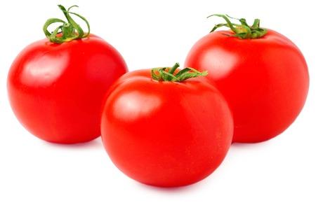 sweet segments: Fresh tomatoes isolated on white.