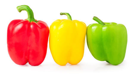 cowardly: red, green and yellow peppers isolated on white Stock Photo