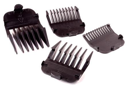 cabello negro: consejos para cortar el pelo aislados en blanco.