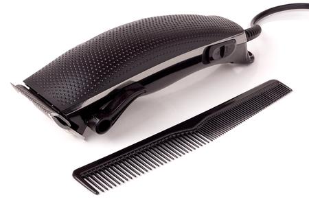 hombres negros: cortadora de cabello aisladas sobre fondo blanco. Foto de archivo