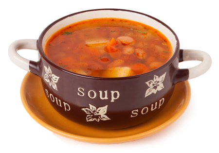 vegetable soup: bean soup in a bowl isolated on white.