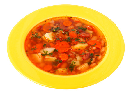 isolated on yellow: bean soup in a bowl isolated on white.