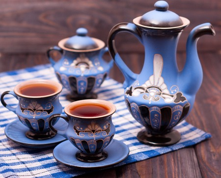 teapot: teapot and two cups of tea on a wooden background. Stock Photo