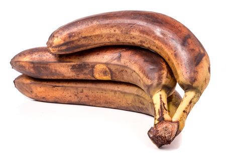 overripe: Overripe bananas in front of a white background.