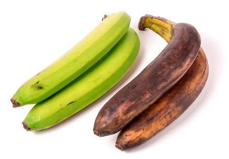 bad banana: Unripe and overripe bananas isolated on white background