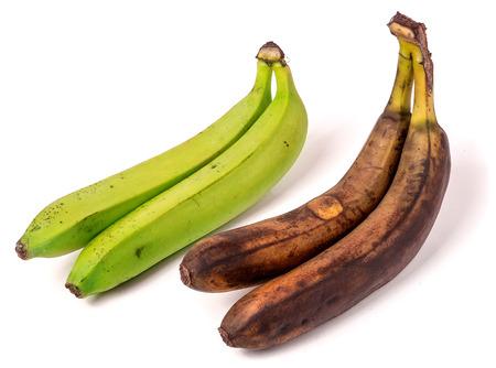 overripe: Unripe and overripe bananas isolated on white background