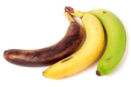 overripe: ripe, overripe, green bananas on white background. Stock Photo