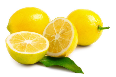 two and a half: two half lemons and whole lemons on a white background. Stock Photo