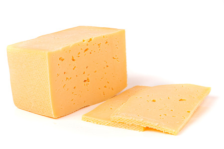 hard cheese: Hard cheese with slices on white background. Stock Photo