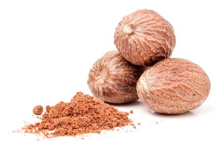 Three nutmeg whole and powder isolated on white background.