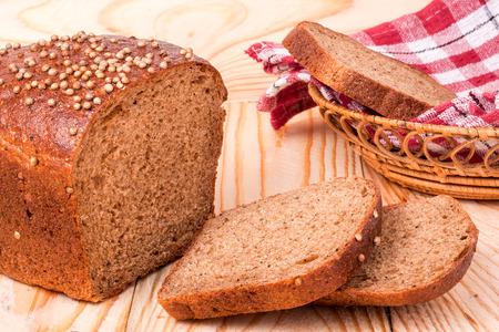 coriander seeds: Black bread with fresh coriander seeds closeup
