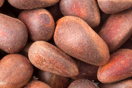 pine nuts: raw whole pine nuts macro as background. Stock Photo