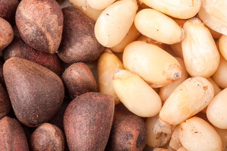 pinoli: pine nuts or whole peeled macro background.