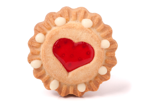 strawberry jam sandwich: one cookie with jelly and heart on a white background.