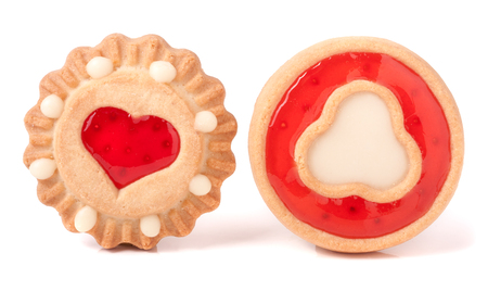 strawberry jam sandwich: two cookie with jelly and heart on a white background.