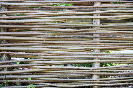 straw twig: Wooden wicker fence made of sticks in the countryside.