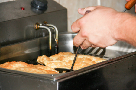 pasty: meat pasty fry in a deep fryer. A traditional dish of the Mongol and Turkic peoples Stock Photo