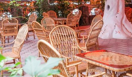 wicker bar: a cozy street cafe with wicker furniture. Stock Photo