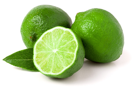 two and a half: two limes with half and leaf isolated on white background. Stock Photo