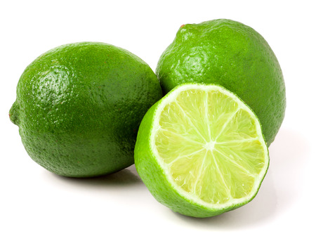 two and a half: two limes with half isolated on white background.
