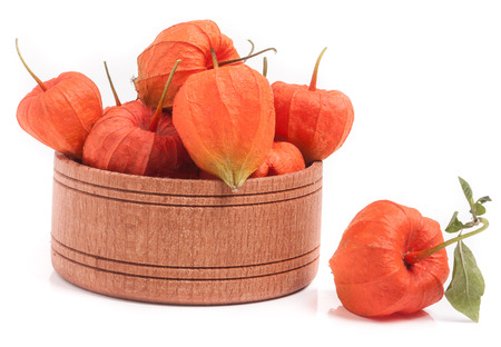 physalis in wooden bowl isolated on white background. Stock Photo
