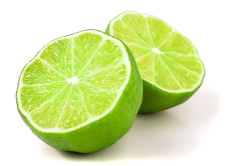 fragrant: two Lime halves isolated on white background. Stock Photo
