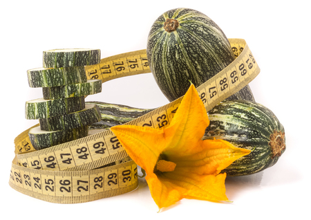 medula: zucchini with measuring tape isolated on white background. Foto de archivo