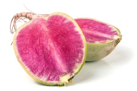 sliced watermelon: one sliced watermelon radish isolated on white background.