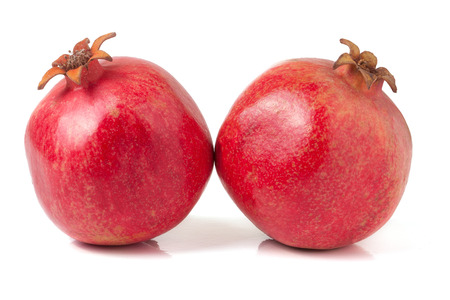 two pomegranate isolated on a white background.