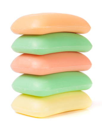 stack of soap of different colors isolated on white background.