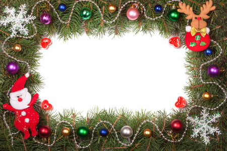 Christmas frame made of fir branches decorated with Santa Claus and balls isolated on white background.