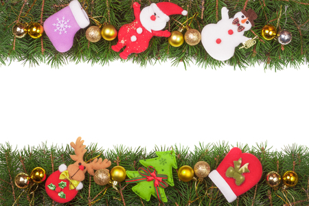 Christmas frame made of fir branches decorated with golden balls Snowman and Santa Claus isolated on white background. Stock Photo