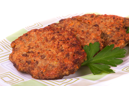 fried liver cutlets or pancakes on a plate isolated on white background.