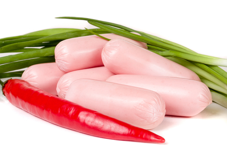 sausages with green onions and chilli isolated on white background closeup.