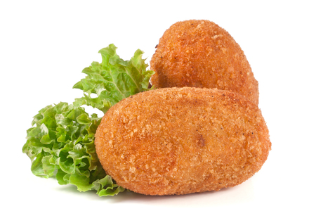 two fried breaded cutlet with lettuce isolated on white background