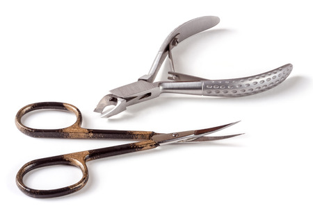 pinching: nail scissors and clippers to remove the cuticle care products isolated on white background