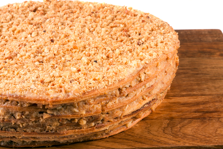 napoleon cake on a cutting board isolated  white background Stock Photo