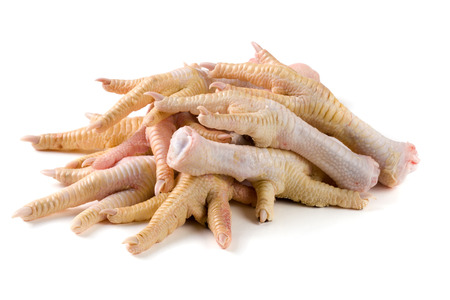 tenon: bunch of chicken feet isolated on white background