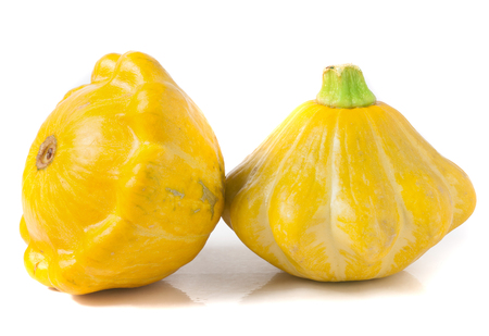 two yellow pattypan squash isolated on white background