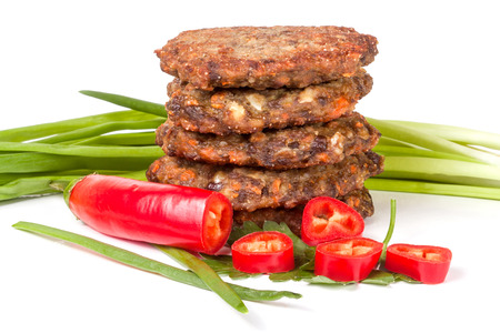 green onions: liver pancakes or cutlets with chili pepper and green onions isolated on white background.