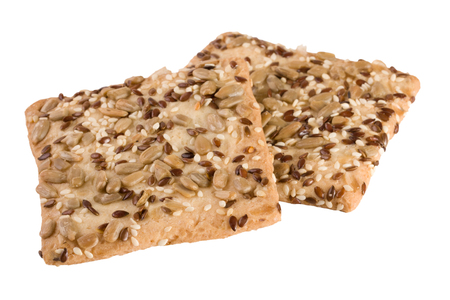 sesame cracker: crispy bread with seeds of sunflower, flax and sesame seeds Isolated on white background