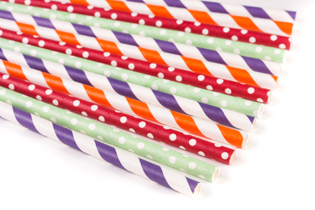 Colorful drinking striped straws isolated on white background Stock Photo