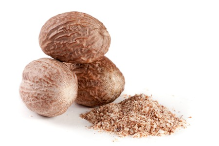 Three nutmeg and powder isolated on white background