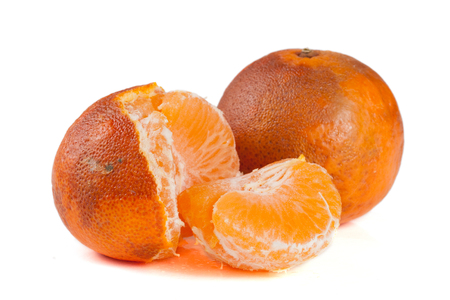 two damaged tangerines isolated on white background